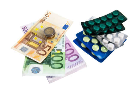 closeup pills and money concept isolated on white background Stock Photo - 18259711