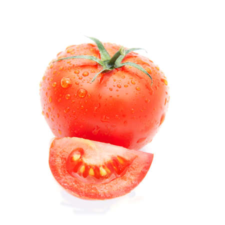 tomato slice: fresh tomato and tomato slice with water drops isolated on the white background Stock Photo