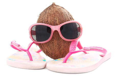 beachwear: happy coconut concept for travel agency with sunglasses and beachwear isolated on white background
