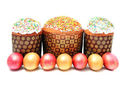 slavic: Easter cake with sugar glaze and painted eggs isolated on white background Stock Photo