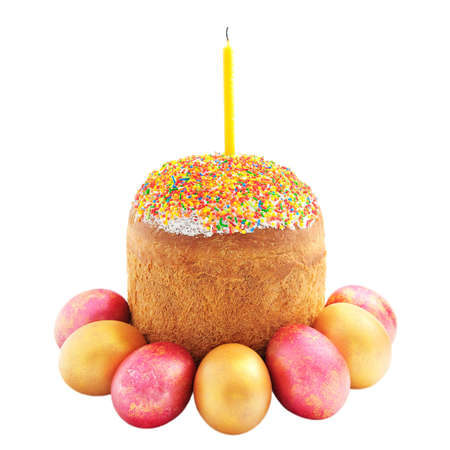 consecrated: Easter cake with sugar glaze, painted eggs and candle isolated on white background