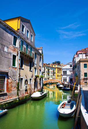 row of houses: Venice canal, small bridge, houses and the boats, Italy