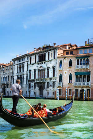 Venice canal with gondola in summer bright day, Italy Stock Photo
