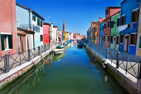 gaily: Venice, Burano island, small brightly-painted houses and channel