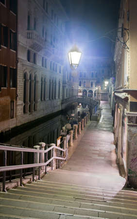 Venice canal, street and bridges at night, Italy photo