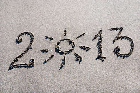 Happy New Year 2013 on the sea beach with the sun Stock Photo - 18493076