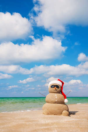 beach happy new year: Sandy snowman. Holiday concept can be used for New Years and Christmas Cards