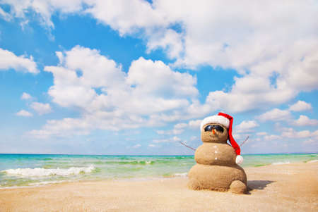 christmas in july: Sandy snowman. Holiday concept can be used for New Years and Christmas Cards
