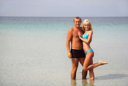 loving couple on the sea beach at summer photo