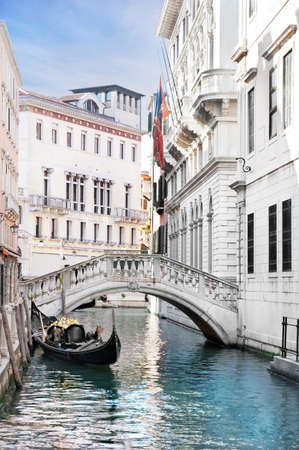 Venice canal with gondola, Italy in summer bright day photo