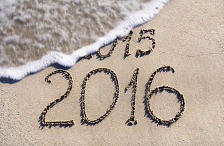 Happy New Year 2016 replace 2015 concept on the sea beach 스톡 콘텐츠