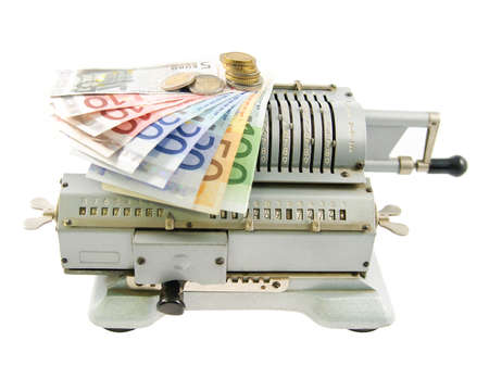 Vintage mechanical adding machine and money isolated on white background photo