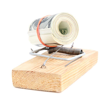 subornation: dollar banknotes roll in a mousetrap as concept of money security or bait Stock Photo