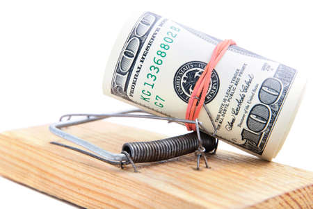 subornation: dollar banknotes roll in a mousetrap as concept of money security or bait