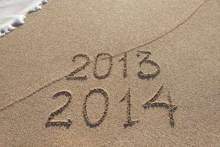 Nueva temporada de A�o 2014 viene concepto - inscripci�n 2013 y 2014 en una playa de arena photo