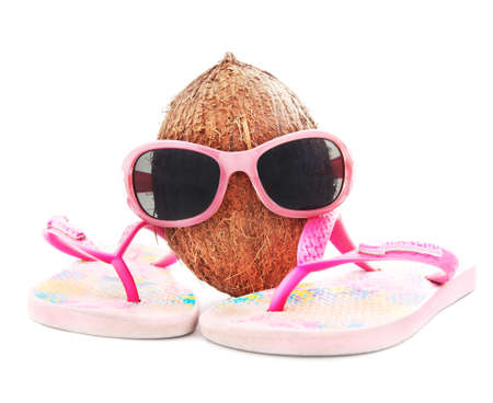 beach wear: happy coconut concept for travel with sunglasses and beach wear isolated on white background