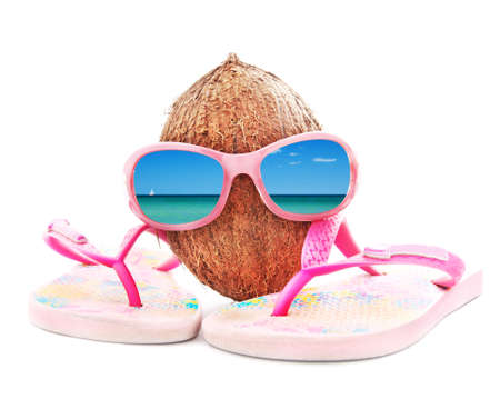 beach wear: concept for travel with sunglasses, coconut, beach wear and sea beach reflection isolated on white background