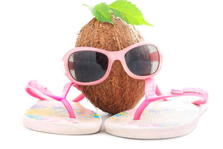 happy coconut concept for travel agency with sunglasses and beachwear isolated on white background