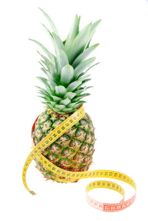 dietology: Pineapple and tape measure isolated on white background as reducing weight concept