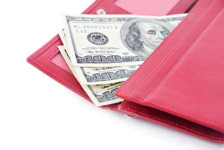 red purse: red leather wallet closeup with money isolated on white background