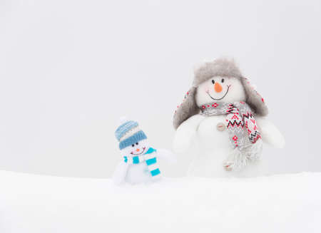 Happy winter snowmen family or friends background (copy space) photo