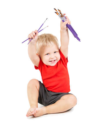 happy year-old child as small artist with paint brushes Stock Photo