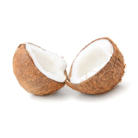 two halfs of coconut with milk isolated on white background photo