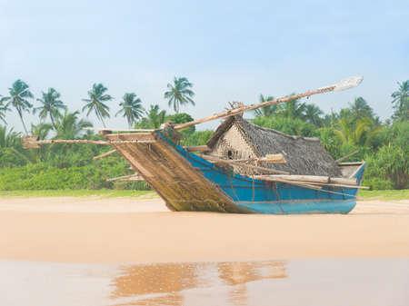 Fishing boat at beautiful sandy ocean palm beach, Indian Ocean photo