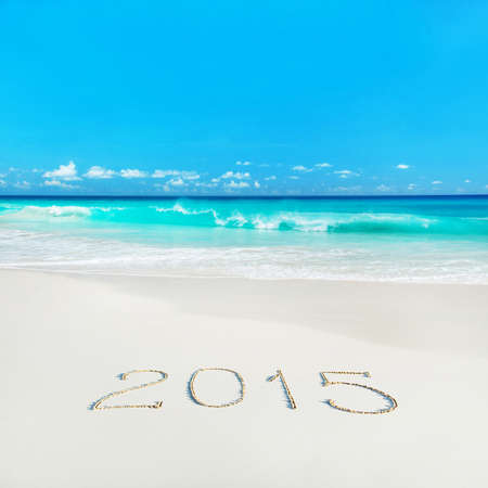 beach happy new year: Happy New Year 2015 season concept on azure tropical sandy beach - winter vacation in hot countries background