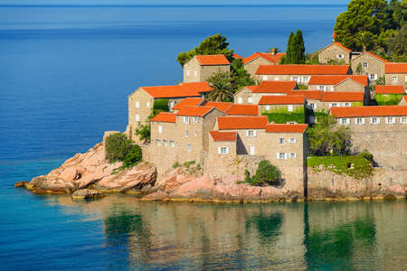 Sveti Stefan, small islet and hotel resort in Montenegro, southeast of Budva. Balkans, Adriatic sea, Europe. Travel destinations background.