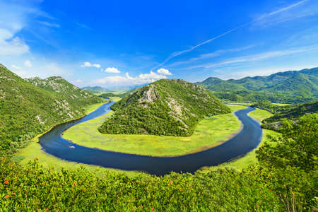 Canyon of Rijeka Crnojevica river in Skadar Lake National Park. One of the most famous views of Montenegro. The Green Pyramid and the bend of the river between mountains.