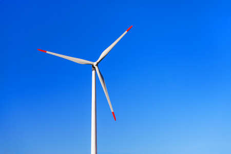 electric blue: Windmill for renewable electric energy production against blue sky Stock Photo