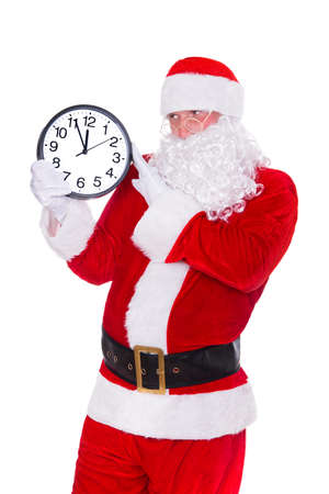 Christmas Santa Claus pointing at clock showing five minutes to midnight. Isolated on white background. Happy New Year concept.
