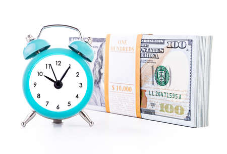 Ten thousand united states dollars currency banknotes bundle and green clock isolated on white background. Time is money financial successful business profits concept. 스톡 콘텐츠