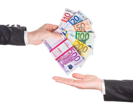 Business woman hand in black office suit with euro banknotes packages as fantail give money to empty hand. Stacks of tens, twentys, fiftys, one, two, five hundreds Euros isolated on white background 스톡 콘텐츠