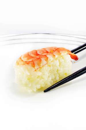 hashi: Shrimp Sushi with chopsticks isolated over white background