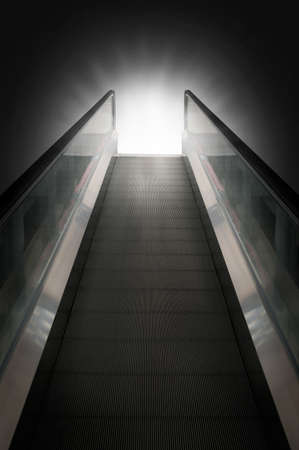 Escalator of walkway to success on background photo