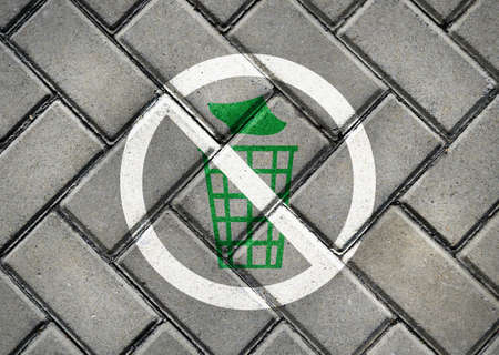 needless: Do not litter sign on patterned pavement