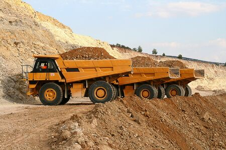 Mining trucks dumper excavator earth mover photo