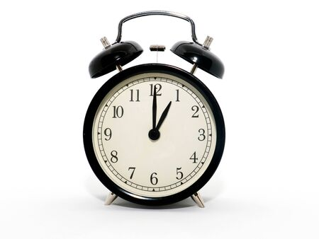 Old-style alarm clock, black and white, it's one o'clock.