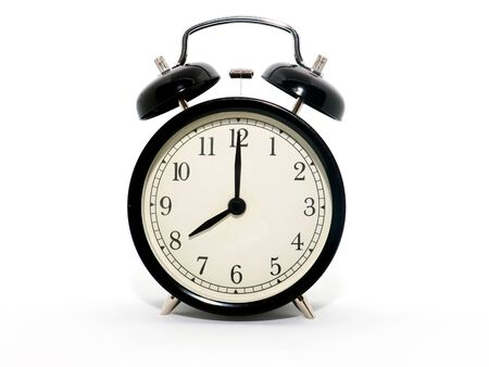 Old-style alarm clock, black and white, it's eight o'clock.