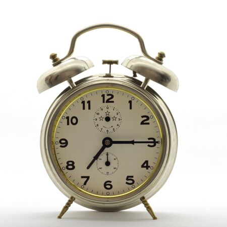 Old-style alarm clock, metal, it's quarter past seven.