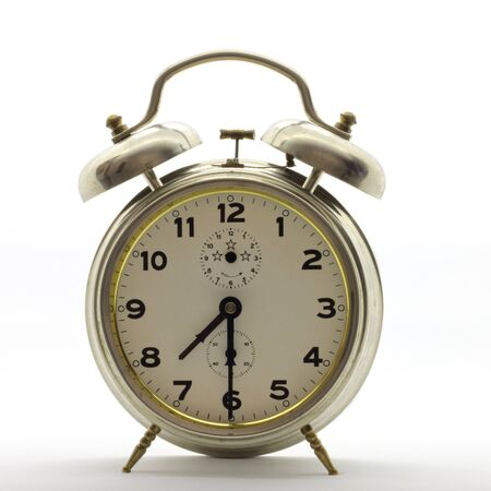 Old-style alarm clock, metal, it's half past seven.
