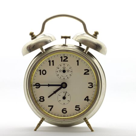 Old-style alarm clock metal, it's quarter to eight.