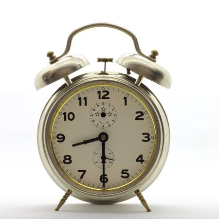 Old-style alarm clock, metal, it's half past eight.