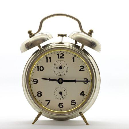 Old-style alarm clock, metal, it's quarter past nine.