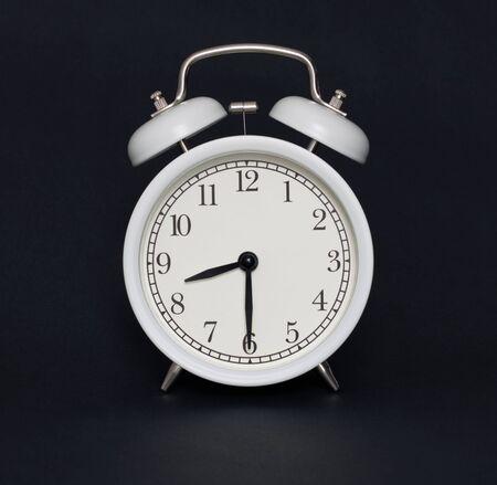 Old-style alarm clock, black and white, it's half past eight. Stockfoto