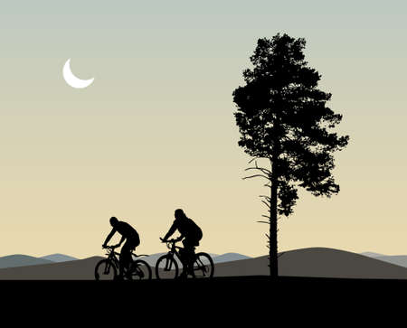 Silhouette of two bikers and evening landscape with trees