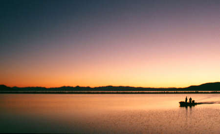 return trip: Silhouette on a lake