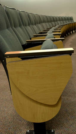 A row of chairs in an auditorium.